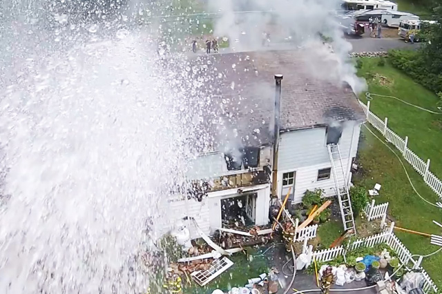 TRACKIMO-FI-Drama-Ensues-as-Firefighters-Spurt-Water-at-Drone-with-Their-Hose