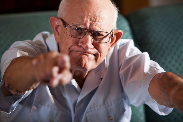 Old man pointing