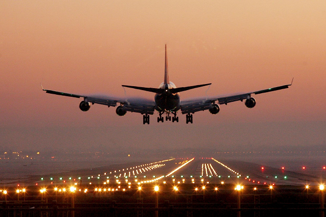 Plane Landing on Runway