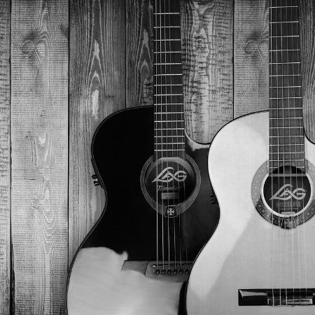 Two Guitars and a Wooden Background
