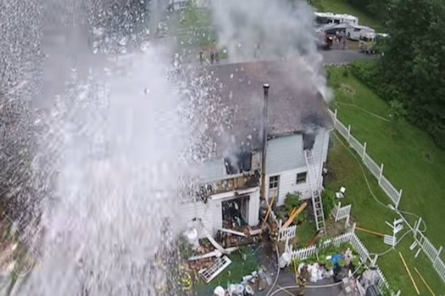 Firefighters Spurt Water at Drone